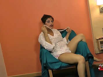 Rupali playing with her fat pussy on sofa fingering deep inside